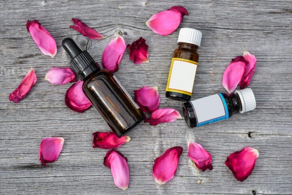 essential oils with rose petals