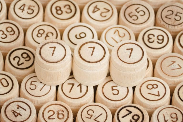 777 on wooden blocks surrounded by other numbers
