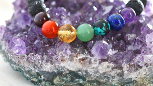 chakra bracelet on amethyst crystal