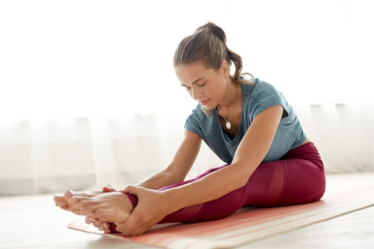 woman doing yoga to recharge herself