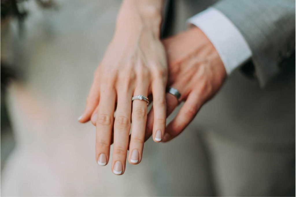 couple hands with wedding bands can numerology predict marriage?