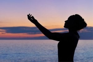spiritual woman reaching for sky - how to be more spiritual without religion