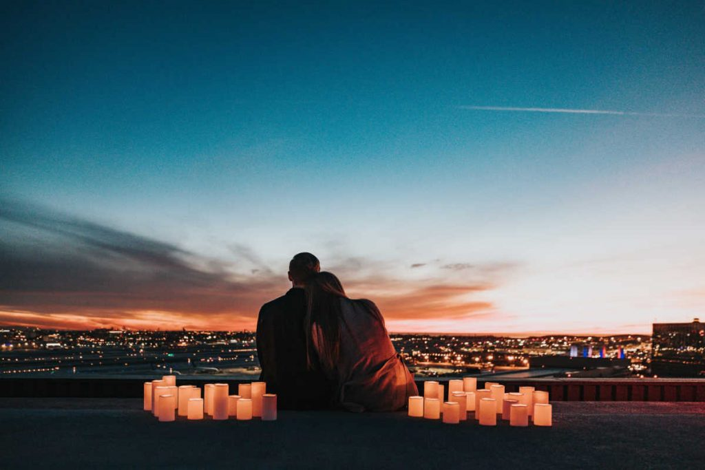 couple in love surrounded by candles