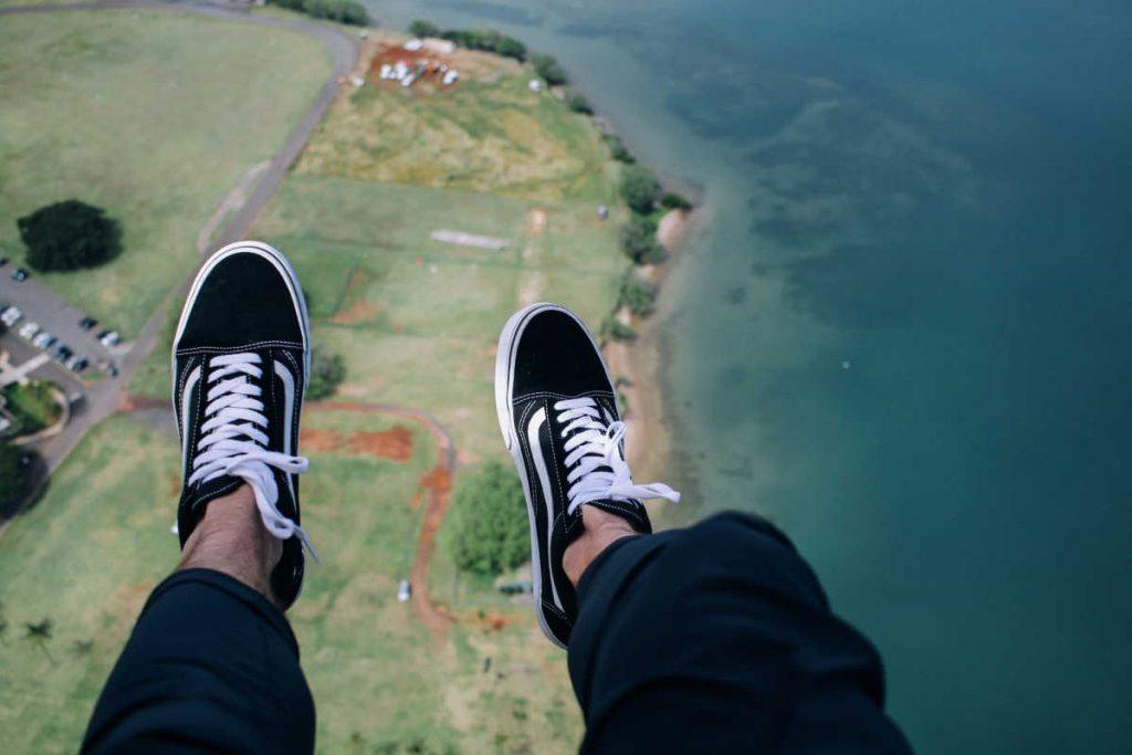 man's feet skydiving