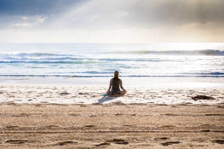woman meditation on beach