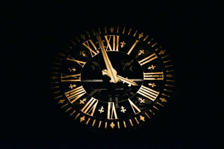 gold clock with black background