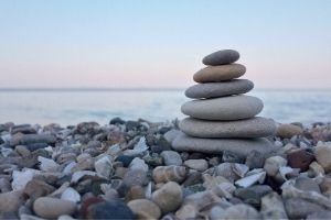 rocks balanced on beach