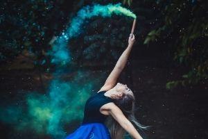 dancer holding blue flare